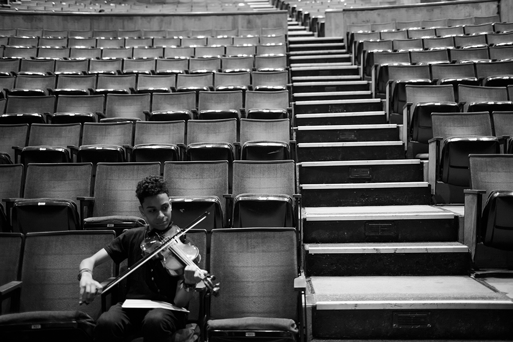 "Chavi Leon practices violin before a concert, directed by Professor Kim Cai, the High School for Violin and Dance, May 12, 2016, Lehman College, Bronx, New York. Following practice, the students will perform their year-end concert for the public. From ""Haven."""