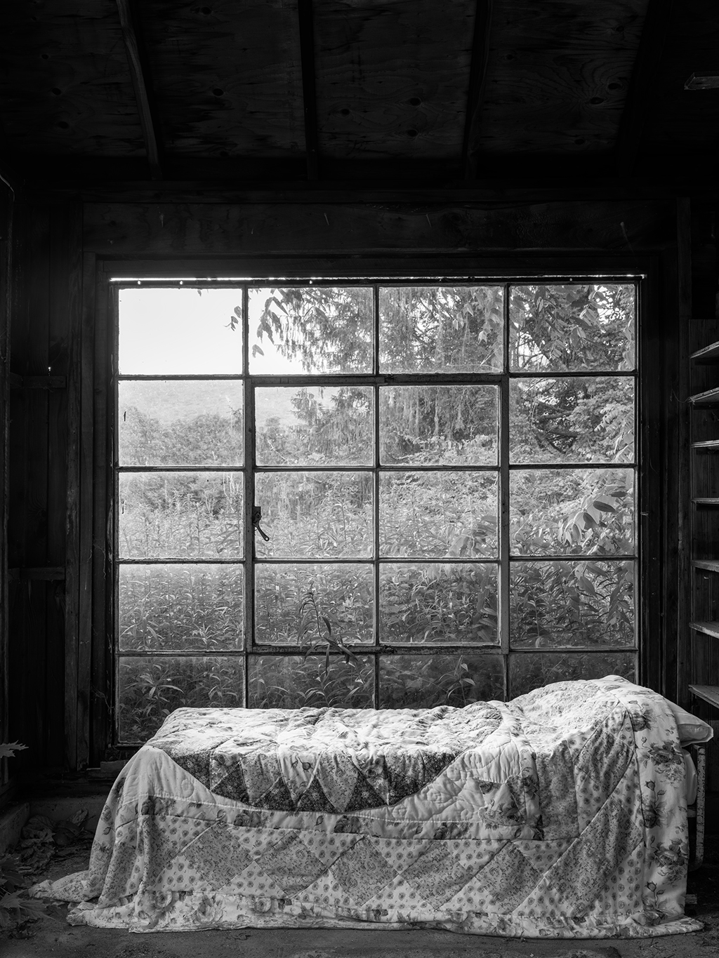 "Barn Bed, New Jersey: ""We found this bed with a beautiful quilt in an abandoned barn in New Jersey,"" says Crane. ""I photographed the bed about 10 different ways, as if I was working with my 8x10 view camera. I shot it high and low, and with a wide-angle lens, a slightly longer lens and a normal lens."""