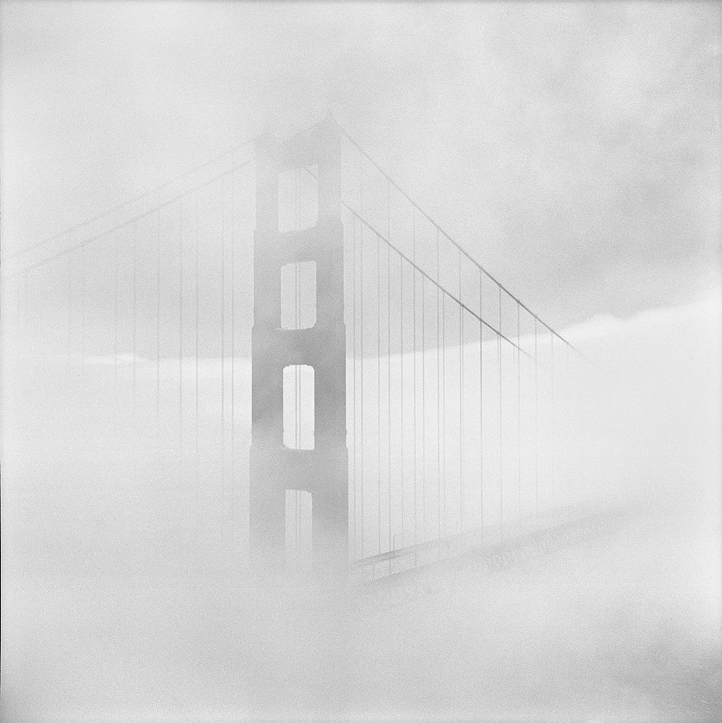"""Fog Shrouds the North Tower of San Francisco's Golden Gate Bridge"" by Fred Lyon."