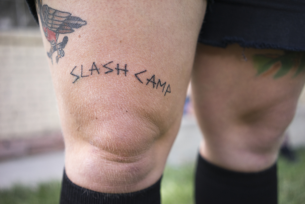 Elyse Clouthier models the SLASH CAMP tattoo